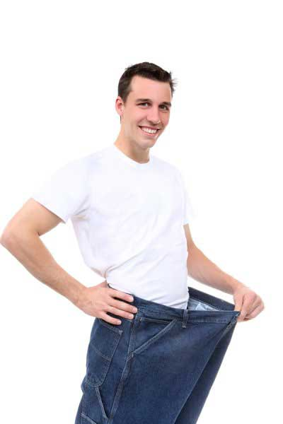 Man after weight loss showing his jeans