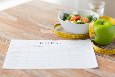 Diet plan and fruit on table
