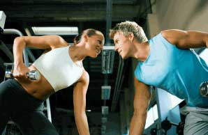 Young boy and girl doing exercise in the gym